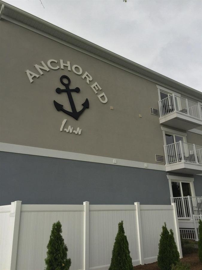 Anchored Inn sign on the outside wall